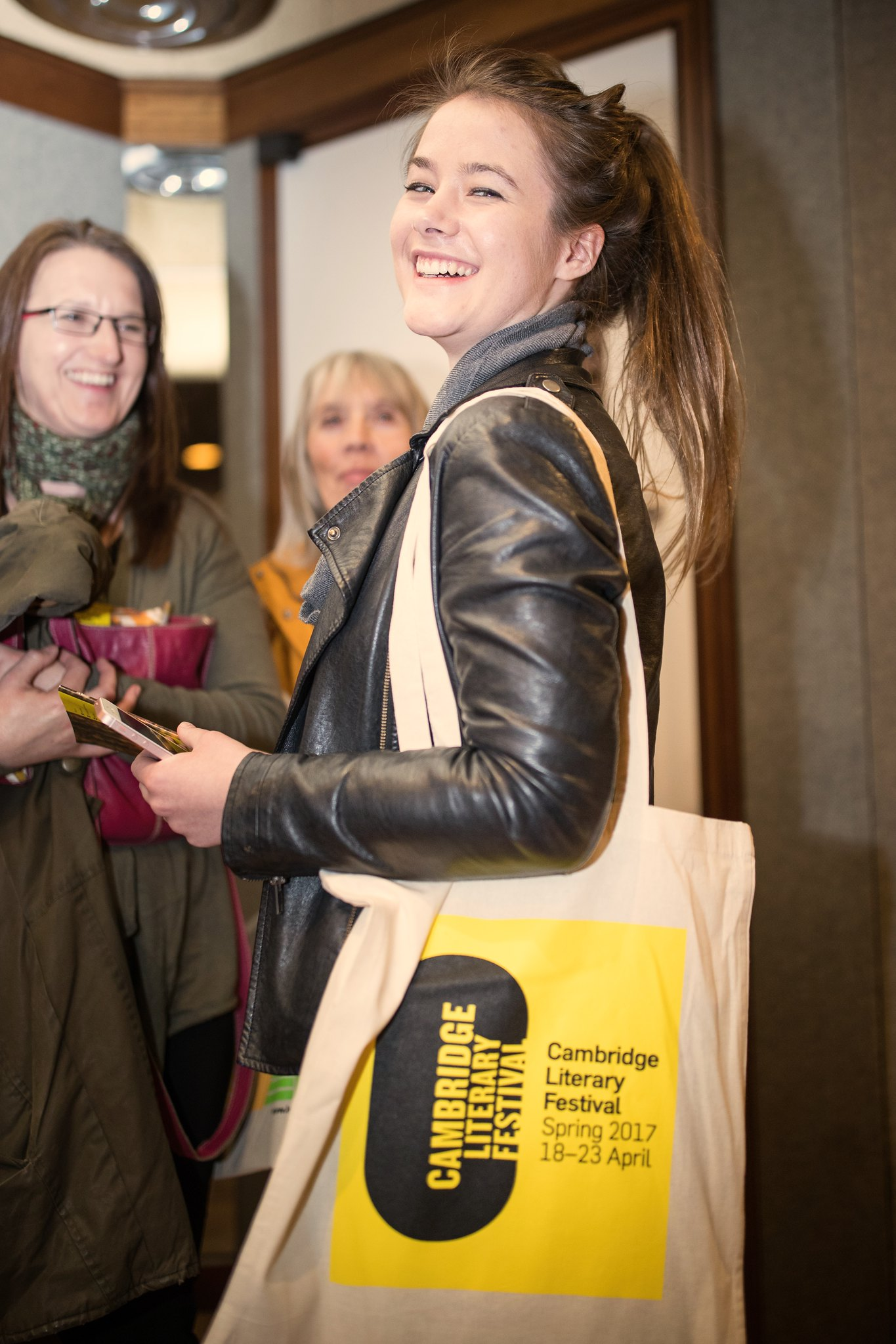 young lady with CLF bag